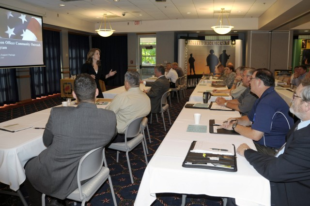 Christina Burhans speaks at the Threat Management Team Conference at Fort McCoy, Wis. She attended the conference as a result of a Department of Homeland Security grant.
