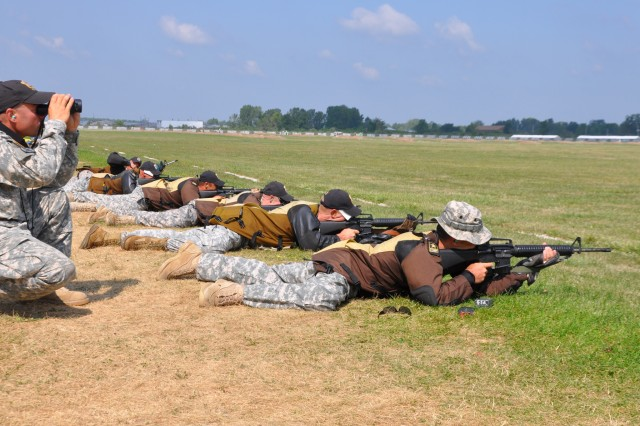 CAMP PERRY, Ohio – Soldiers from the U.S. Army Marksmanship Unit fire on their targets from 600 yards away during the National Infantry Trophy Rifle team match Aug. 6. The USAMU won the match, soundly defeating 41 other six-man teams. (Photo by Michael Molinaro, USAMU PAO)