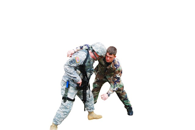 Gordon and Staff Sgt. Troy Cochran, (right) demonstrate the hook technique, which is executed by reaching under the armpit of the opponent and then hooking your arm up on top of the shoulder.