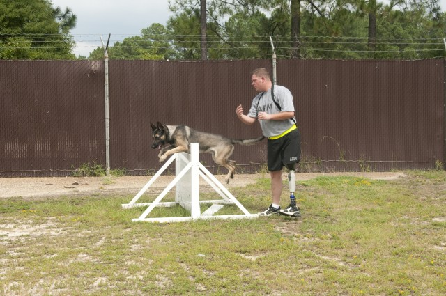 Fort Bragg wounded warrior returns to duty as a military working dog handler