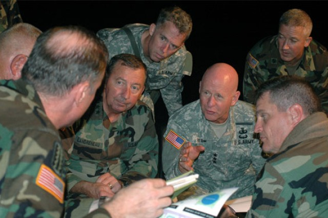 Army Lt. Gen. H Steven Blum, former chief of the National Guard Bureau, center, and Army Maj. Gen. Bennett Landreneau, the adjutant general for Louisiana, left of Blum, met outside the Superdome in New Orleans, Sept. 1, 2005, to discuss plans for supporting the massive relief mission in the aftermath of Hurricane Katrina.