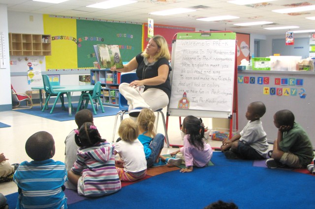 "Victoria Barrera, Child, Youth and School Services pre-kindergarten teacher, reads ""The Kissing Hand"" by Audrey Penn to her students Aug. 24 in the classroom at the Youth Activities Center. Barrera is a first-year teacher and will be responsible for helping guide the social and academic development of 24 students."