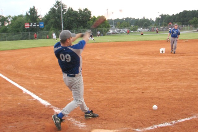 Capt. Kavit Beyersdorf, an optometrist at the Bayne-Jones Army Community Hospital, Fort Polk, La., takes a swing at a ball during a home run derby competition Aug. 19.
