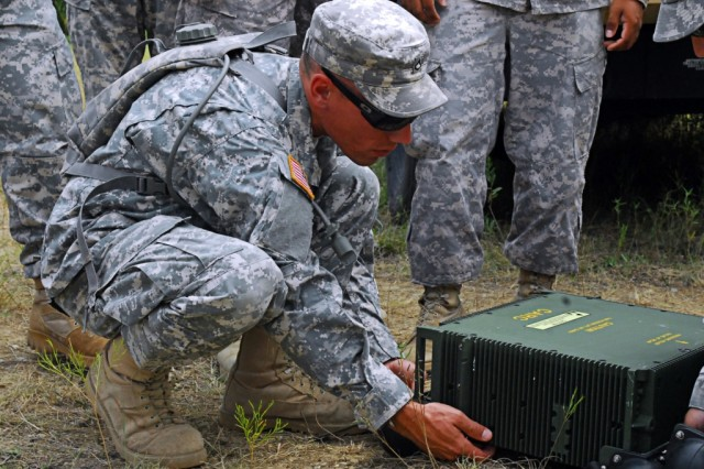FORT HOOD, Texas-Pfc. Jeff Headman, a Minneapolis, Minn. native and a communications specialist with 2nd Special Troops Battalion, 2nd Brigade Combat Team, 1st Cavalry Division, helps set up a High-Capacity Line-of-Sight Radio during training, here, Aug. 26.