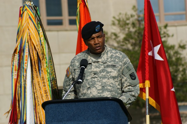 Col. Frederick Henry, incoming deputy commander for operations, gives his remarks during a retreat ceremony Aug. 20 in front of Greely Hall. Henry is coming from the Army Inspector General's office where he served as the chief of their Information Assurance Division.