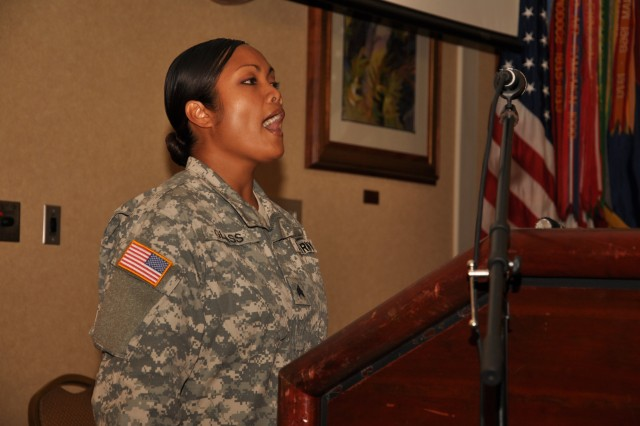"""SGT Daisy Glass, an NCO with 643rd Engineer Co., 84th Engineer Bn., sings the National Anthem prior to the """"Faces of Strength"""" Women's Equality Day Observance ceremony at the Nehelani Banquet and Conference Center, Schofield Barracks, Hawaii, Aug. 27. In addition to performing the National Anthem during the event, Glass also graduated the 25th ID Equal Opportunity Leader Course following the event. (U.S. Army photo by Sgt. Jesus J. Aranda, 25th Infantry Division Public Affairs Office)"""