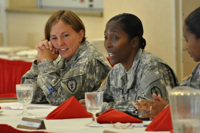 """CSM Valerie Greene, Headquarters and Headquarters Battalion, 25th ID, answers a question as a member of the discussion panel during the """"Faces of Strength"""" Women's Equality Day Observance ceremony at the Nehelani Banquet and Conference Center, Schofield Barracks, Hawaii, Aug. 27. The members of the panel responded to questions including the performance and future of women in the military. (U.S. Army photo by Sgt. Jesus J. Aranda, 25th Infantry Division Public Affairs Office)"""