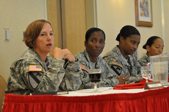"""LTC Emily Schiffer, the deputy SJA, 25 ID, answers a question as a member of the discussion panel during the """"Faces of Strength"""" Women's Equality Day Observance ceremony at the Nehelani Banquet and Conference Center, Schofield Barracks, Hawaii, Aug. 27. Schiffer and her fellow members of the panel drew on their individual experiences and backgrounds to offer personal opinions and advice on the past, present and future of women in the military. (U.S. Army photo by Sgt. Jesus J. Aranda, 25th Infantry Division Public Affairs Office)"""