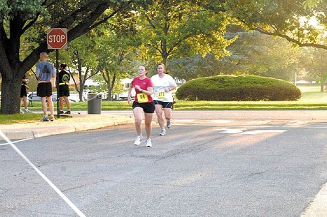 Runners from Joint Base Myer-Henderson Hall compete during a fun run and walk to celebrate WomenAca,!a,,cs Equality Day.