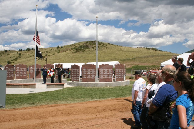 CRIPPLE CREEK, Colo. - The Wall, honoring local fallen warriors, is rededicated during the 18th Annual Salute to American Veterans Rally and Festival in Cripple Creek Aug. 21.