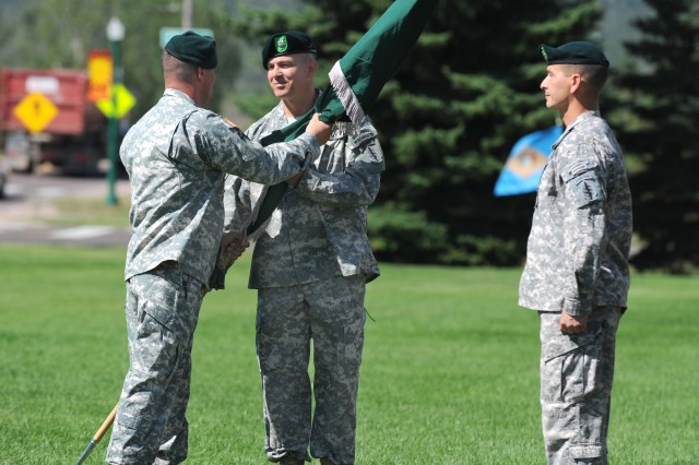 Lt. Col. John Taft, commander, 4th Battalion, 10th Special Forces Group (Airborne), center, accepts the guidon from 10th SFG (A) commander Col. Sean Swindell as Command Sgt. Maj. Luis Pauka looks on during the battalion's activation ceremony Aug. 19 on Fort Carson, Colo.