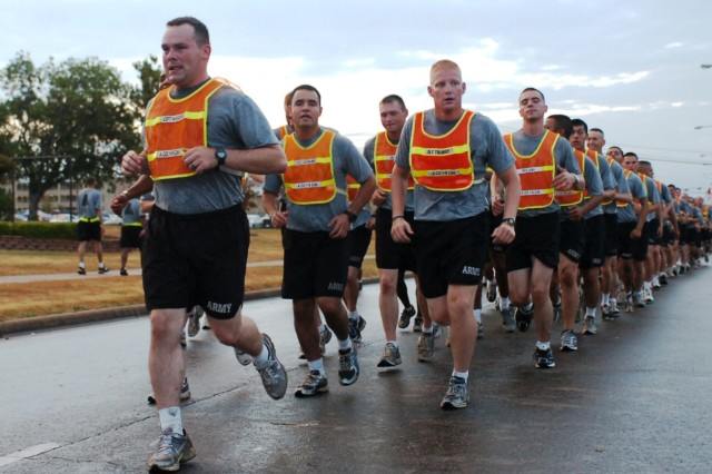 """FORT HOOD, Texas- The command team and Soldiers from A Company, 1st Battalion, 8th Cavalry Regiment, 2nd Brigade Combat Team, 1st Cavalry Division, participate in a brigade run on Fort Hood, Aug. 30 in celebration of """"Black Jack's"""" birthday.  The brigade was formed more than 90 years ago with its earliest missions being rough riding and border patrols."""