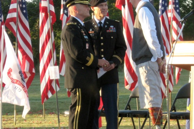 Maj. Gen. Yves J. Fontaine (left), Army Sustainment Command commanding general, and ASC Command Chaplain (Maj.) Charles B. Rizer, Jr., speak with B.J. Jackson before the opening the Davenport, Iowa, All-Era Veterans Healing Field event, Aug. 27. Jackson lost both his legs to a bomb explosion in Iraq.