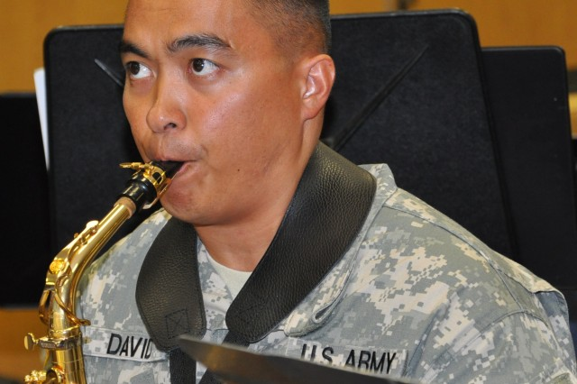 Staff Sgt. Matthew David, 25th Infantry Division Band, plays a saxophone during rehearsal for their performance in China and Russia Aug. 27 at Schofield Barracks, Hawaii. The band is traveling to China and Russia for ten days to perform at different events and represent the U.S. military.