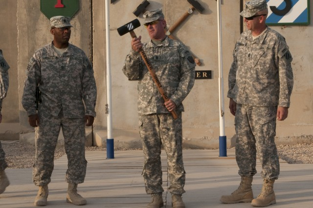 "Command Sgt. Maj. Lawrence Wilson, United States Forces - Iraq command sergeant major, examines a sledgehammer present to him to commemorate his visit to Contingency Operating Site Kalsu and troops of the 3rd ""Sledgehammer"" Advise and Assist Brigade,3rd Infantry Division, Aug. 23. Wilson, who  ends a 21 month tour as the senior enlisted Soldier in Iraq on Sept. 1, made an effort to visit each of the three U.S. Divisions inIraq, as well as each of the six Advise and Assist brigades.(U.S. Army Photo by Sgt 1st Class Roger Dey)(released)"""