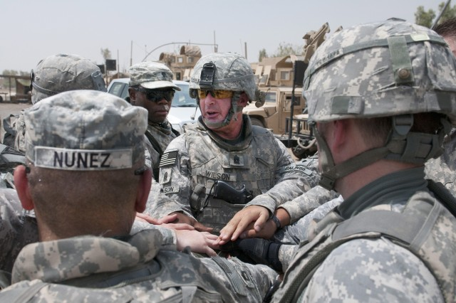 """Command Sgt. Maj. Lawrence K. Wilson says a few words to the members of his personal security detachment Aug. 23, before rolling out in MRAPs on his last tactical ground movement as the United Stated Forces-Iraq command sergeant major.  Wilson visited the Soldiers of 3rd Advise and Assist Brigade, 3rd Infantry Division Contingency Operating Site Kalsu on one of his final battlefield circulations to thank them for a job well done. (U.S. Army Photo by Sgt 1st Class Roger Dey)(released)"""""""