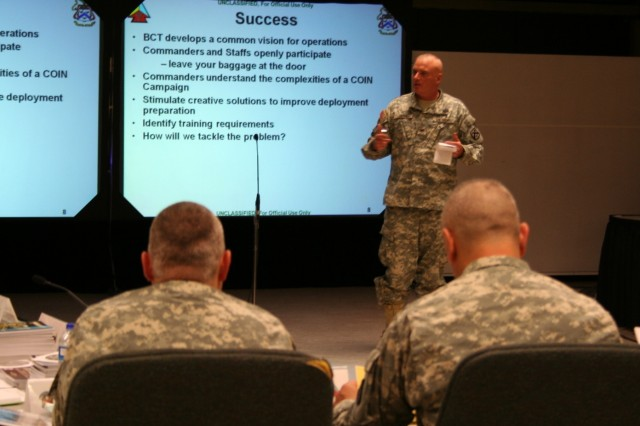 The Battle Command Training ProgramAca,!a,,cs Col. Tony Deane leads a Battle Command discussion during a mid-August Battle Command Seminar for the 170th Infantry Brigade Combat Team. (Official Army photo)