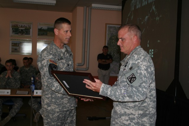 Col. Tony Deane (right) congratulates 170th Commander Col. Patrick Matlock on his unitAca,!a,,cs successful completion of Counter Insurgency (COIN) training.
