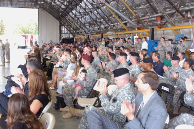 Friends, family and honored guests applaud during the  Army Air Operations Group Change of Command ceremony at Davison Army air Field, Ft. Belvoir, Aug. 31.   Col. Scott Sanborn assumed command from Col. Jill Ludowese.