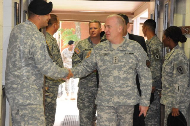 Lt. Gen. Rick Lynch, U.S. Army Installation Management Command commander, is greeted by Capt. Cameron Albert, A Co., 1st Bn., 13th Avn. Regt. commander, at the post dining facility at Fort Rucker Aug. 31. Lynch had breakfast with post officials and members of 1st Bn., 13th Avn. Regt. before touring the installation, and meeting with other Soldiers and officials.