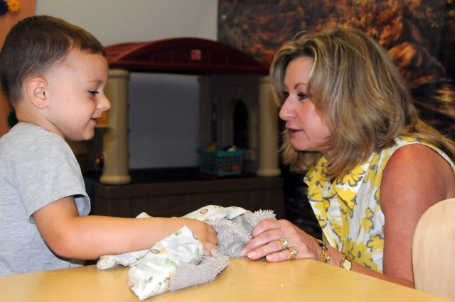 Gage Zimmer shows Sarah Lynch, wife of Lt. Gen. Rick Lynch, IMCOM commander, his favorite blanket at Fort Rucker's Bowden Terrace Neighborhood Center Aug. 31. Lynch toured the facility and military housing during her visit to Fort Rucker while her husband met with Soldiers and post officials.