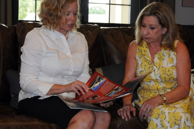 Amanda Filipowski, Picerne Military Housing communications manager at Fort Rucker, goes over brochures for homes located in Bowden Terrace with Sarah Lynch, wife of Lt. Gen. Rick Lynch, IMCOM commander, at the Bowden Terrace Neighborhood Center Aug. 31. Lynch toured the facility and military housing during the installation visit, while her husband met with Soldiers and post officials.
