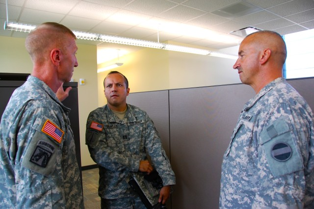 (L-R) Incoming U.S. Army Forces Command/U.S. Army Reserve Command Special Troops Battalion command sergeant major, Sgt. Maj. Kevin Graham, incoming Headquarters and Headquarters Company, FORSCOM, commander,  Capt. Jorge Vargas, and Sgt. Maj. Jeffrey Marcon, FORSCOM G4 (Logistics) sergeant major discuss Soldier relocation issues at FORSCOM/USARC (Forward), Aug. 31, 2010 at Fort Bragg, N.C.  The headquarters of each command is relocating from Fort McPherson, Ga. as directed by the 2005 Base Realignment and Closure legislation.