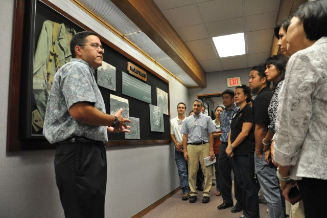Adam Elia, the Division Historian for 25 Inf. Div., speaks briefly of the role the division played during World War II to the visiting members of the Hawaii's Pacific Century Fellows Class of 2010 during their tour of Schofield Barracks, Hawaii, Aug. 31. The HPCF was founded by Mayor Mufi Hannemann in order to create a closely-bonded network of promising community leaders who will work together for bettering Hawaii's future.