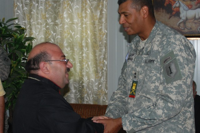 Maj. Gen. Vincent Brooks, commanding general of the 1st Infantry Division and United States Division-South, speaks with Emad Al-Banaa, the archbishop of southern Iraq, during an Iftar celebration on Contingency Operating Base Basra Aug. 28. Al-Banaa is the top Chaldean clergyman for the same nine provinces in which USD-S operates.
