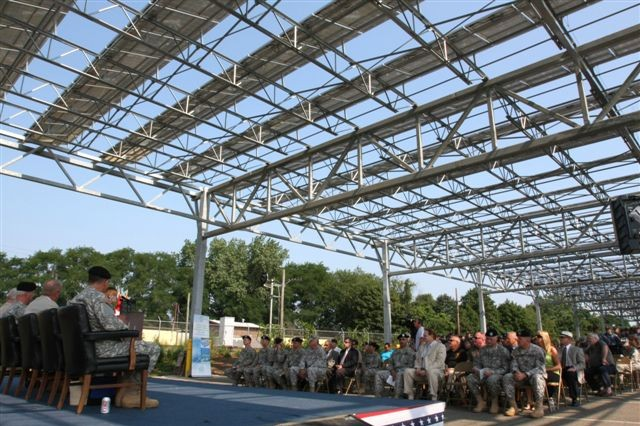 A ceremony takes place beneath the carport solar power structure built by the U.S. Army Corps of Engineers New York District at the National Guard's National Training Facility Headquarters in Sea Girt, N.J.