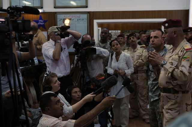 Iraqi Army Maj. Gen. Ali Jassim Mohammed Hassen al-Frejee (right), commanding general of the 17th Iraqi Army Division, answers reporters' questions Aug. 30 at Joint Service Station Deason, Iraq.