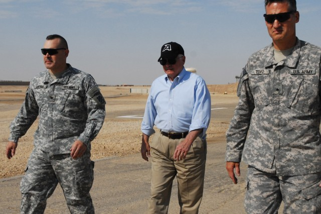 CAMP RAMADI, Iraq - Col. Lou Lartigue (from left), commander of 4th Advise and Assist Brigade, 3rd Infantry Division, United States Division - Center; U.S. Secretary of Defense Robert Gates; and Brig. Gen. Kenneth Tovo, deputy commanding general-west for USD-C, walk the flight line Sep. 1 at Camp Ramadi, Iraq. (U.S. Army photo by Staff Sgt. Tanya Thomas, 4th AAB, 3rd Inf. Div., USD-C)