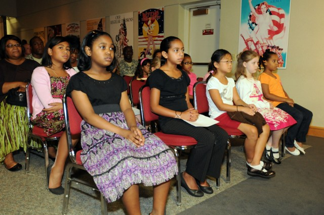 Female students from Macdonald Intermediate School attended Fort Knox's Women's Equality Day Celebration on Aug. 27, at the Patton Museum's Abrams Auditorium.  Women's Equality Day, which is celebrated every year on Aug. 26, came about as part of a peaceful civil rights movement by women in 1848 at the world's first women's rights convention in Seneca Falls, New York. (U.S. Army photo by Sgt. Michael Behlin)