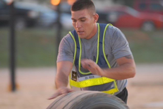 SSG Denny Rush rolls a tire down a 25-meter lane during the Sept. 1 Mailed Foot Challenge, a Survivor-style physical training event bringing together cadre from across 2nd Battalion, 54th Infantry Regiment.
