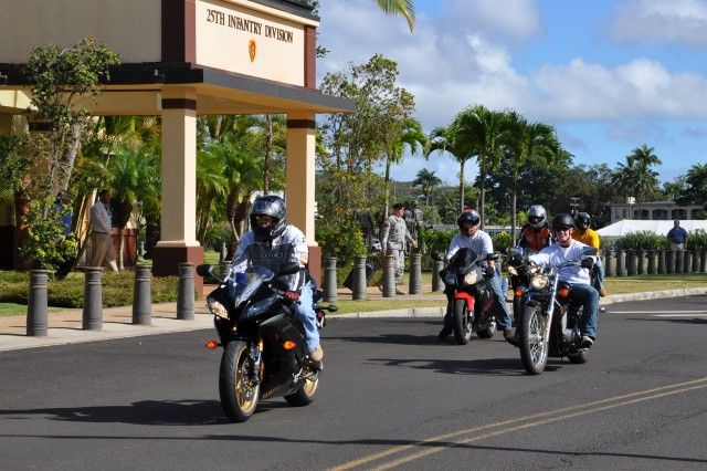 "Riders representing the 25th Infantry Division's ""Pacific Thunder"" motorcycle ride begin their 64-mile tour of Oahu at Fernnandez Hall, Schofield Barracks, Hawaii, Sept. 02. ""Pacific Thunder"" is a quarterly mentorship and safety ride for all units within the 25th Inf. Div. in observance of the Labor Day weekend."