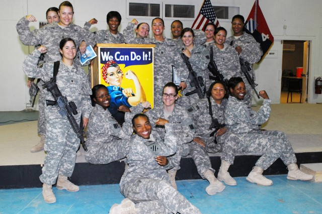 Female Soldiers with 4th Advise and Assist Brigade, 3rd Infantry Division, United States Division - Center, pose for a photo after the 2010 Women's Equality Day observance held at the Ramadi Event Center, Aug. 26.
