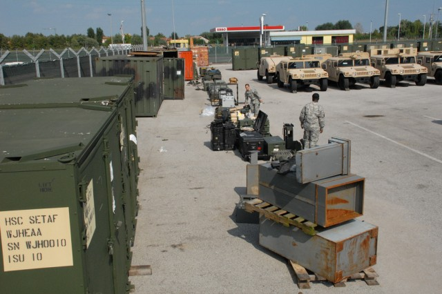 U.S. Army Africa's award-winning Supply team inspects excess property for disposal on Caserma Ederle, Vicenza, Italy, Aug. 25.