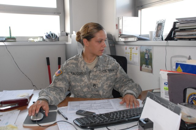 Staff Sgt. Tasha Falcon takes care of business, documenting the disposal of excess property at Caserma Ederle in Vicenza, Italy, Aug. 25.