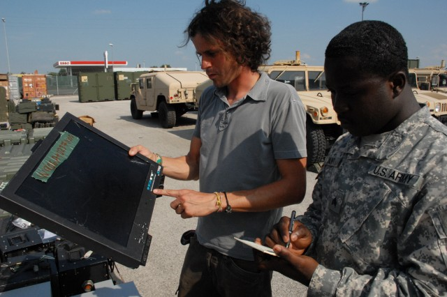 Maximillian Casity and Sgt. Kwaku Anti process excess property for disposal on Caserma Ederle, Vicenza, Italy, Aug. 25.