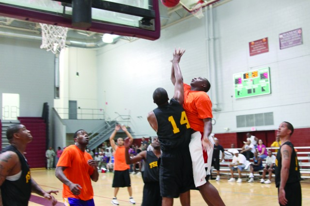 FORT LEE, Va. - The basketball competition heats up as the Soldier Support Institute (black) takes on the Quartermaster School (orange) in one of the final games of the day. The Combined Arms Support Command, Sustainment Center of Excellence hosted the second annual Sustainment bowl here, Sept. 1. The purpose is to promote unit camaraderie through friendly competition of the schools. Some of the events Soldiers and Army civilians participated in included basketball, trap, shooting, baseball, soccer and a 5K run. This year's winner was the Quartermaster School.