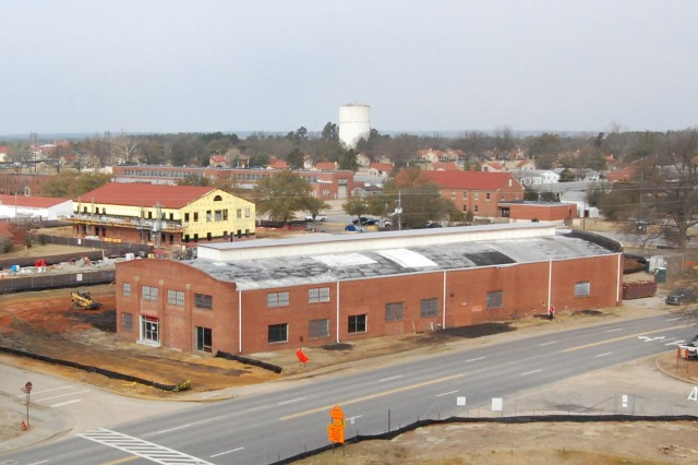 The Firestone Building, shown in this Feb. 24, 2010, photo, served as an auto repair shop under various concessionaires over the years and now is undergoing renovation to serve as temporary work space to support the relocation of the headquarters elements of U.S. Army Forces Command and U.S. Reserve Command from Fort McPherson, Ga., to Fort Bragg, N.C.  Working closely with the North Carolina State Historic Preservation Office, the U.S. Army and supporting contract firms are taking necessary measures to preserve the historic nature of the building.