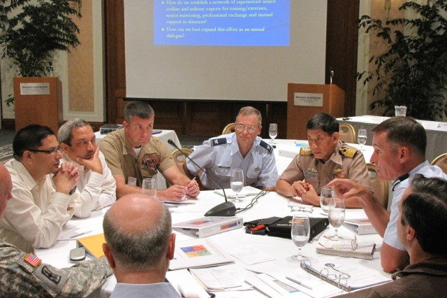 HONOLULU, Hawaii (September 1, 2010) - Senior civilian and military  participants discuss the way forward on regional disaster response  coordination during the Asia Pacific Senior Civil Military Seminar. From left  to right: Maj. Gen. Joseph J. Chaves (Deputy Commander, Army National Guard  USARPAC), Jaya Mukunda Khanal (Joint Secretary, Nepal Ministry of HomeAffairs), Amit Jha (Joint Secretary, India National Disaster Management Agency),  Col. Christopher Coke (Chief of Staff, 3d MEB), Col. Mark Bednar  (USPACAF), Special Captain Sanyalak Rungsampan (Deputy Director of Joint and  Combined Exercise Planning Office, Thailand), Brig. Gen. Michael Keltz (USPACAF), and John Brause (USAID Deputy Assistant Administrator). USAmbassador to Nepal, Scott Delisi, is in the foreground.