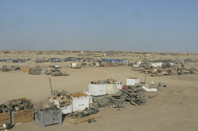 The Contingency Operating Base Adder scrap yard is sorted into several clearly marked sections after 15 weeks of labor from U.S. Soldiers deployed to the base and two local contractors. What used to be 75 acres of uncontrolled dumping ground is now a functioning scrap separation and segregation area.