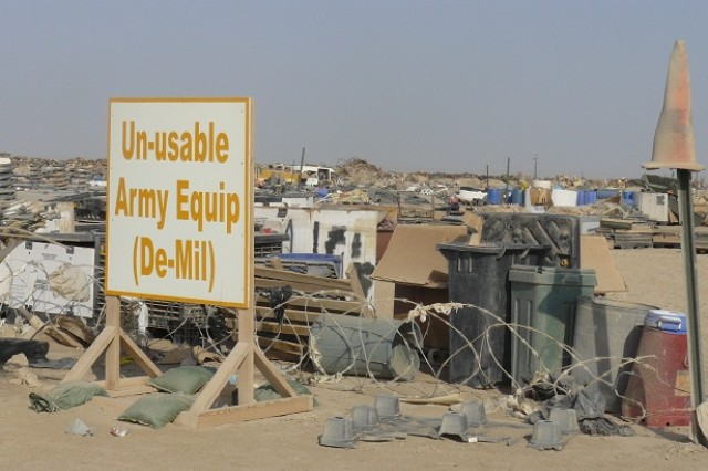 A sign is posted by U.S. Forces as the designating the demilitarized equipment staging area at Contingency Operating Base Adder. After years of uncontrolled dumping at the base going back to the Gulf War, United States Division-South began the scrap metal separate and segregate mission.