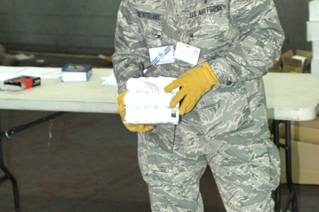 Lt. Col. Jacqueline Garcia-Castellanos inventories supplies in preparation for MEDFLAG 10, a joint military operation involving various U.S. units and the Armed Forces of the Democratic Republic of Congo. Garcia-Castellanos, of the 482nd Medical Squadron, Homestead Air Reserve Base, Fla., is the chief of dental services. MEDFLAG 10 gets under way Sept. 6 in Kinshasa and continues through Sept. 18.