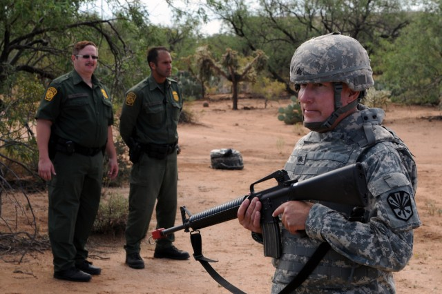 Border Patrol agents observe an unnamed Arizona National Guard soldier training for Operation Copper Cactus on Aug. 25, 2010. Operation Copper Condor is the Arizona National Guard's contribution to the up to 1,200 National Guard troops being deployed to support the Border Patrol and Immigration and Customs Enforcement in four Southwest border states.