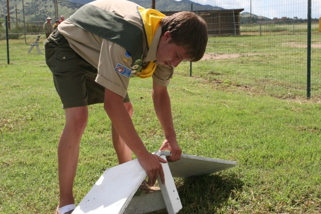 Leon Ross, Eagle Scout, inspects one of the obstacles at Fort Huachuca's dog park.
