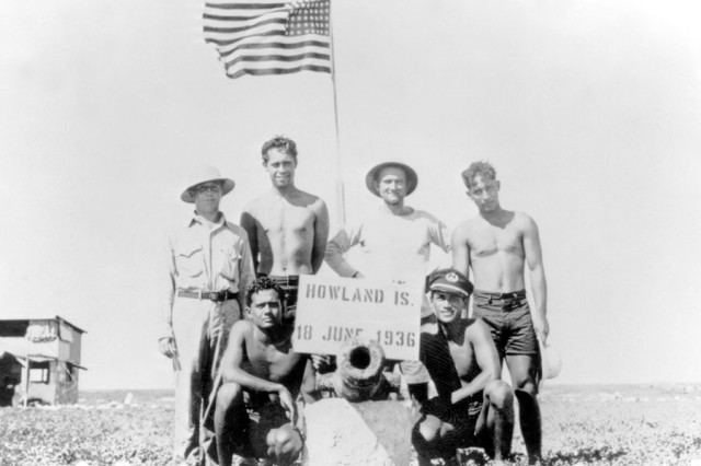 HOWLAND ISLAND - William Stewart Markham, Kini Pea, Killarney Opiopio, James Kamakaiwi and two undentified military personnel pose on Howland Island in June 1936. Opiopio and Kamakaiwi were among the first six Kamehameha School for Boys alumni to colonize Howland, Baker and Jarvis islands in 1935.