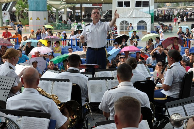"""CW2 Joseph W. Parenteau conducts the 25th Infantry Division band during a historic performance at the America Square Stage during the 2010 World Expo in Shanghai, China. """"Music is an international language that needs no translators,"""" said Parenteau, commander and conductor of the 25th Infantry Division Band. """"The band puts a human face on the U.S. military, which is often viewed as strictly combat arms,"""" he added. The Division band is the first U.S. military band to perform in the World Expo and the first cultural exchange unit in China this year. The division band is in China on an international community relations mission representing the U.S. Army and Pacific Command."""