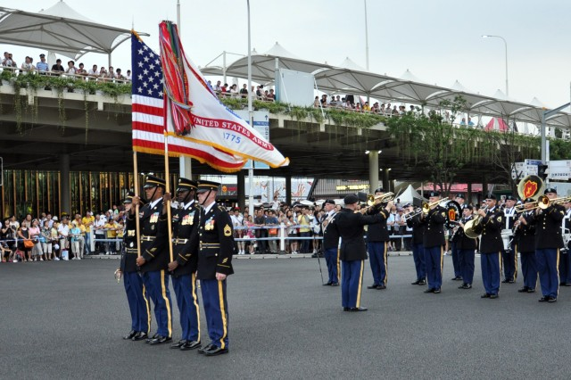 Thousands of spectators lined the streets of the 2010 World Expo in Shanghai, China, waiting to see the 25th Infantry Division Band and Color Guard close out the daily parade as the grand finale. The Division band is the first U.S. military band to perform in the World Expo and the first cultural exchange unit in China this year. The division band is in China on an international community relations mission representing the U.S. Army and Pacific Command.